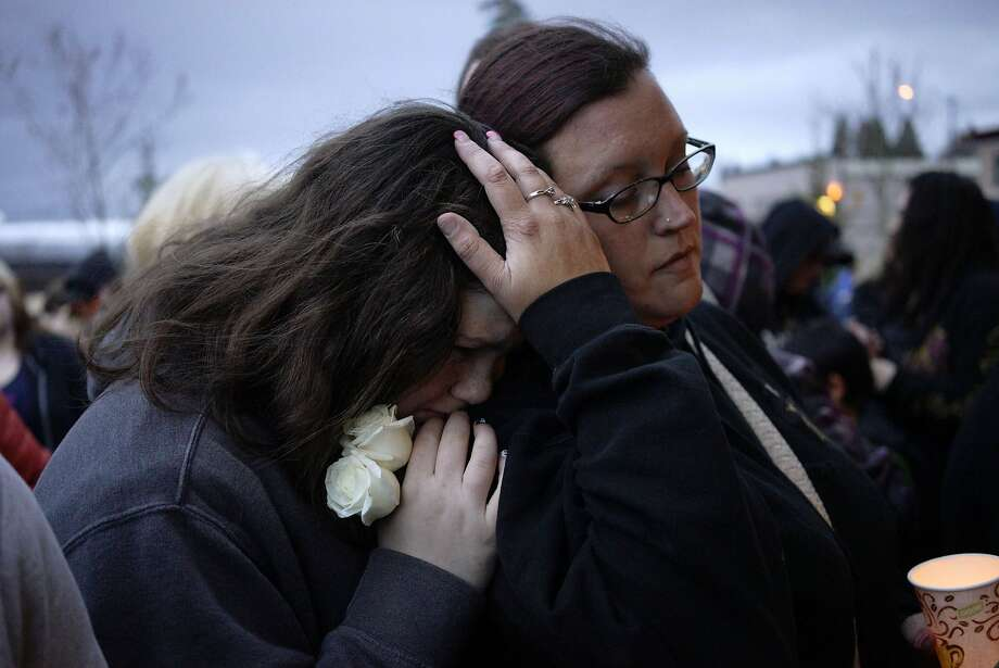 REFILE - UPDATING SECOND SENTENCE  Sarah Halstead (R) comforts her daughter Allison at a candlelight vigil for mudslide victims in Arlington, Washington March 25, 2014. The likely death toll from a devastating weekend landslide in Washington state rose to 24 on Tuesday after rescue workers recovered two bodies and believed they had located eight more, the local fire chief said.   REUTERS/Rick Wilking (UNITED STATES - Tags: DISASTER ENVIRONMENT) Photo: Rick Wilking, Reuters