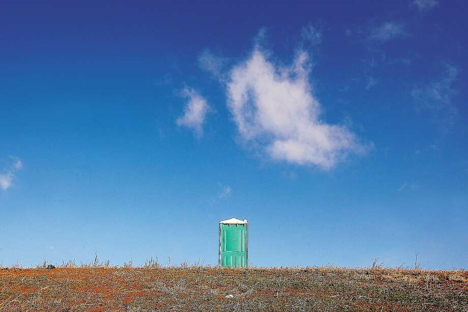 Rest area next exit:A lone portable toilet sits along the shoulder of U.S. Route 67 in West Alton, Mo. Photo: John Badman, Associated Press