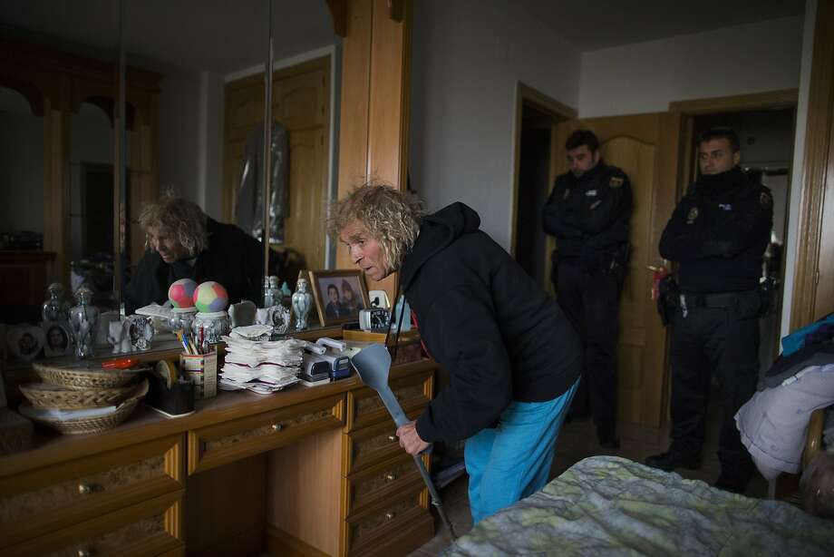 Luis Dominguez Quintana, 77 years old, disabled, picks up his crutches as police enter his apartment to evict him in Madrid, Spain, Tuesday, March 25, 2014. Dominguez Quintana bought a euro 286,000 ($386,000) apartment by taking a mortgage with Bankia bank in 1996 but stopped paying due to his financial situation in 2009, after he lost his business in the construction sector and his property got foreclosed. (AP Photo/Andres Kudacki) Photo: Andres Kudacki, Associated Press