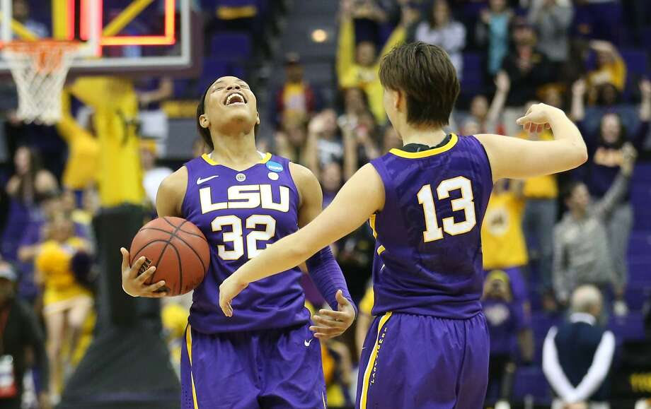 LSU's Danielle Ballard (32) and teammate Rina Hill celebrate their second-round upset of West Virginia. Photo: Crystal LoGiudice, Reuters