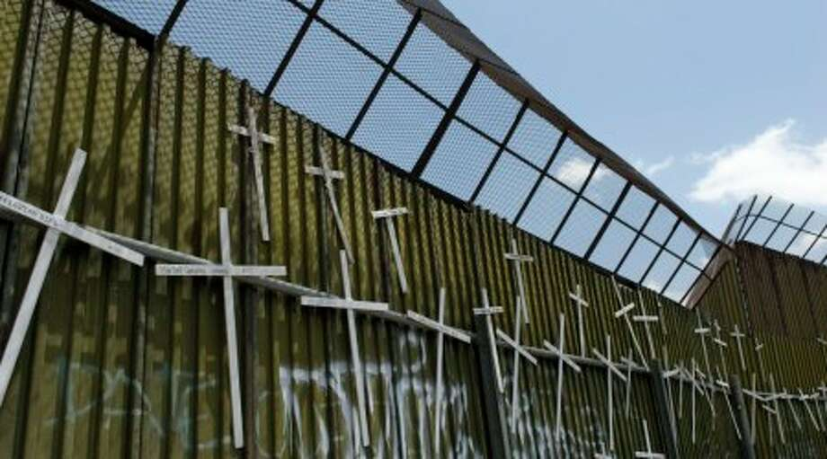 This barrier wall which has been adorned with memorial crosses by the family of the dead wrongly disconnects people across the US-Mexican border.