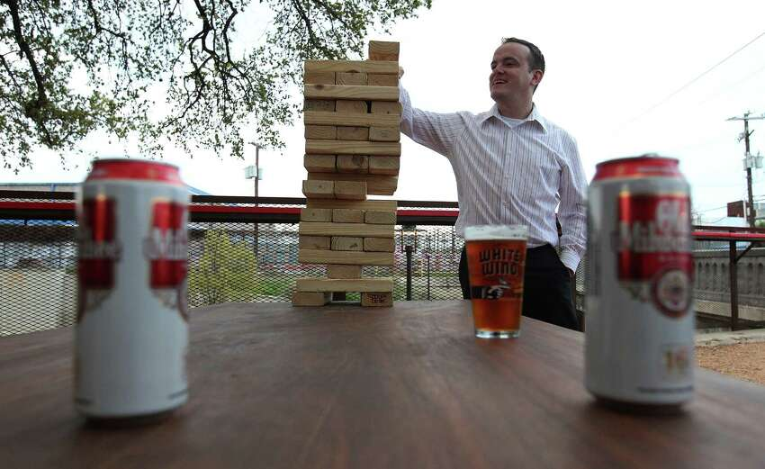 Patron Alfredo Arias plays with a giant wooden block puzzle at the new TacoLand.