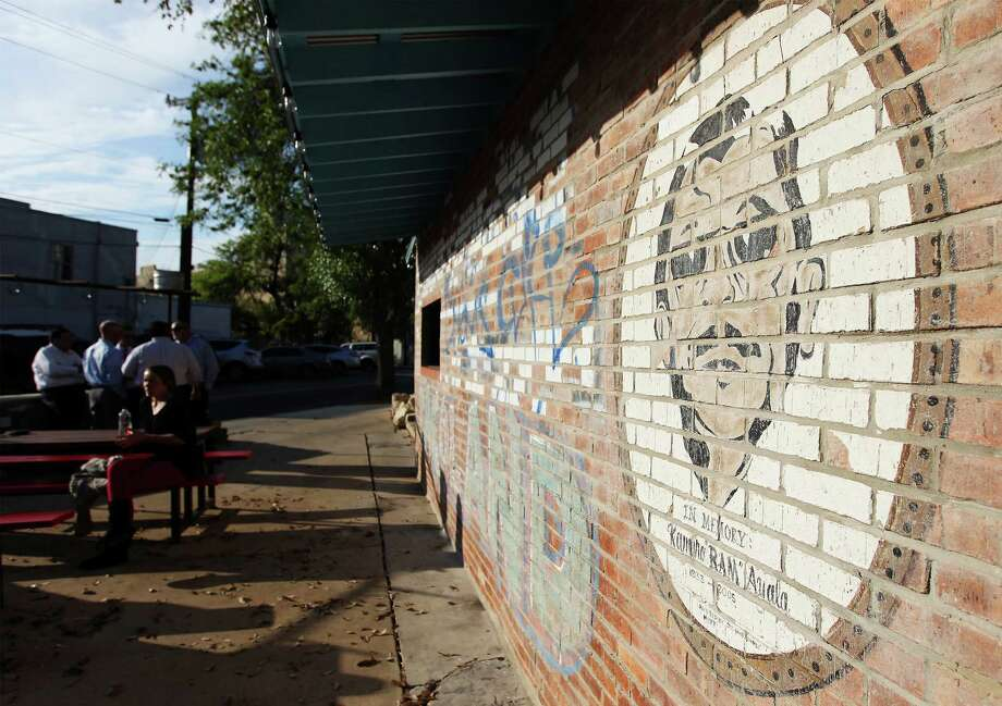 "The mural in honor or Ramiro ""Ram"" Ayala is seen on a wall at TacoLand after the establishment was recently opened by local businessman Chris Erck. Photo: Kin Man Hui, San Antonio Express-News / ©2013 San Antonio Express-News"