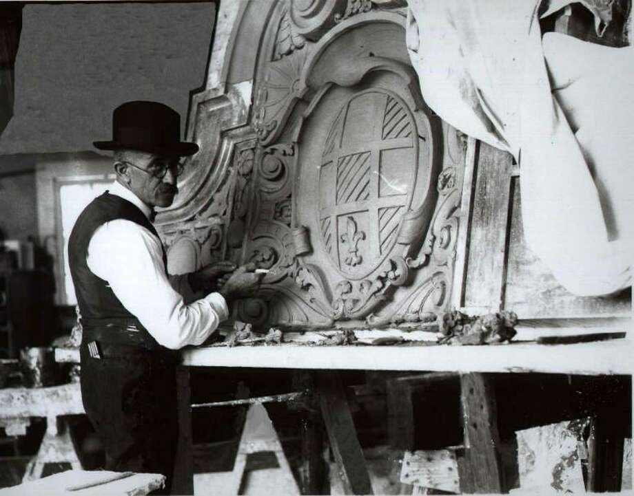 Hannibal Pianta works in his studio on the cartouche that went on a triangular building at 901 E. Houston St.