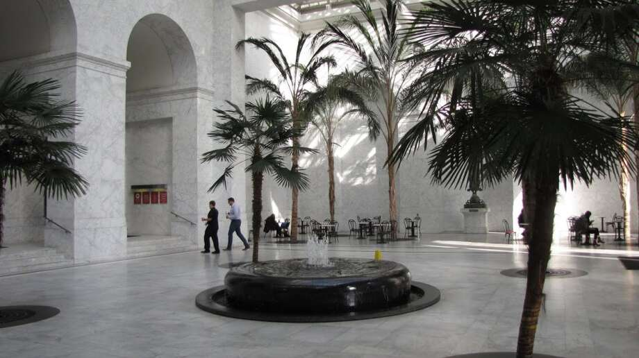 "The semi-outdoor ""conservatory"" at One Sansome (shown here)  is highly visible, slathered in white marble under glass. But there's also a public space INSIDE -- just the place to meet someone for an off-the-record conservation. (Don't stop now!) Photo: John King, The Chronicle"
