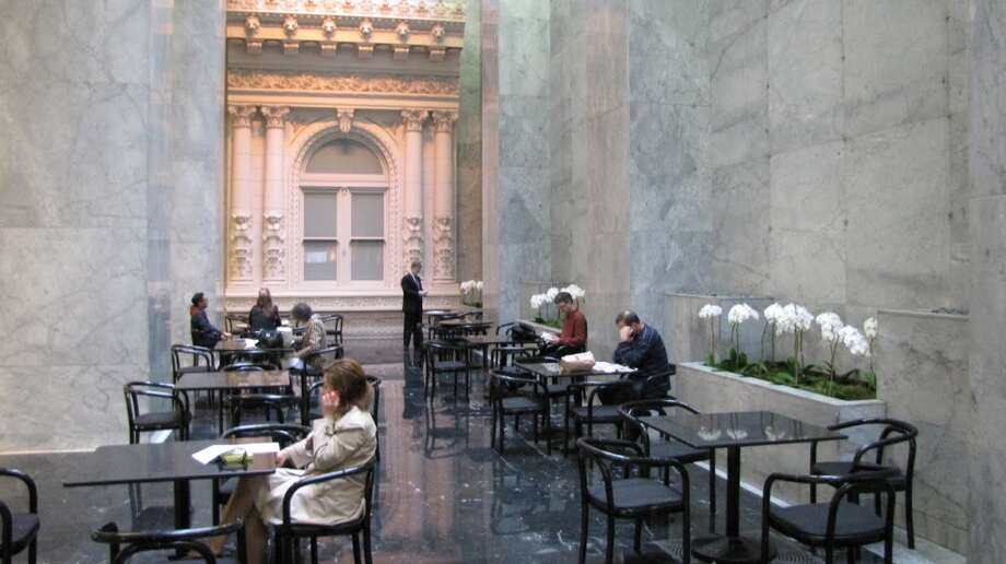 Step inside One Sansome and inside is more white marble -- the tower is from the opulent '80s and proud of the fact -- but also an atrium beyond the coffee bar with soft light and comfortable tables. Photo: John King, The Chronicle