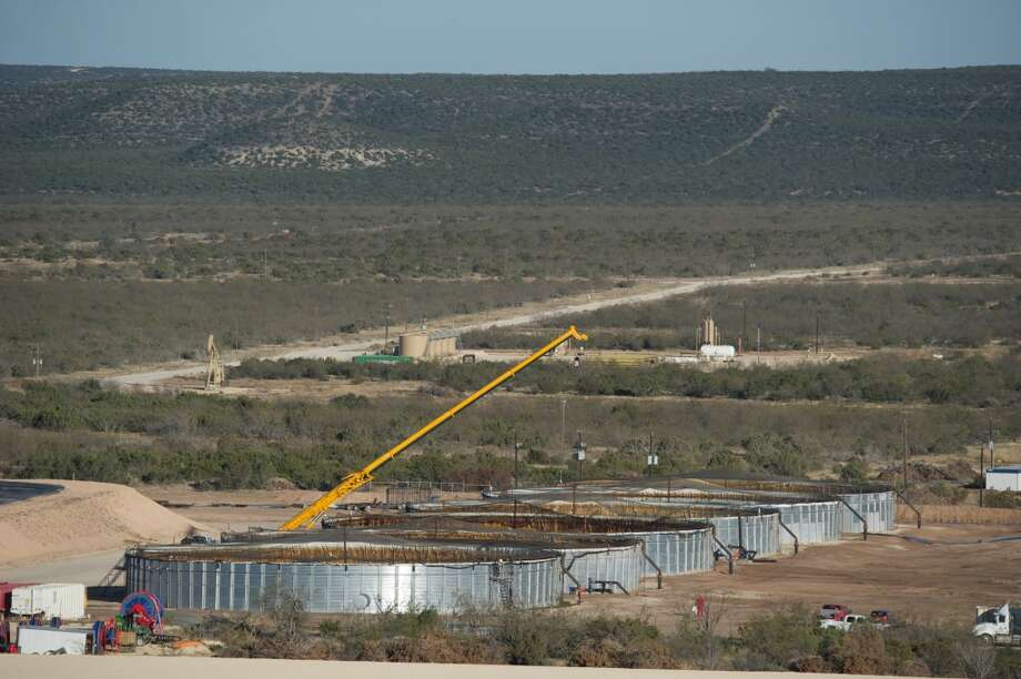 Houston-based Apache Corp. employs re-engineered grain bins to treat produced water   which emerges from wells along with oil and gas -- before recycling it for use in hydraulic fracturing of Wolfcamp Shale wells in the Barnhart area in Irion County, Texas. Photo: Apache Corp.
