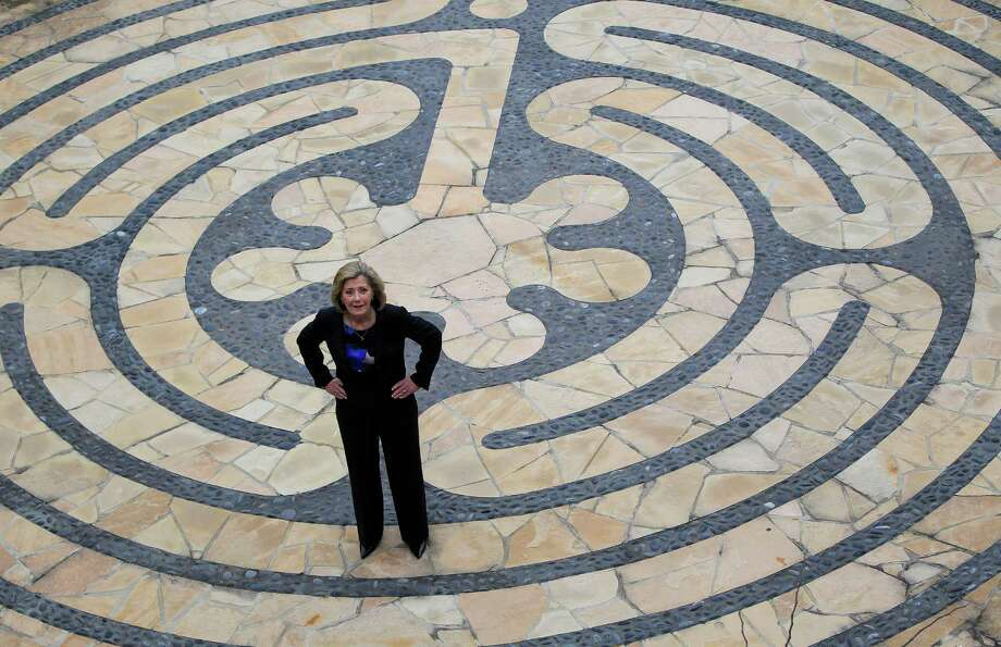 Paula Paust, Executive Director of The Women's Home, stands in the middle of a labyrinth at the Jane Cizik Garden Place, a sober affordable apartment community for women,Wednesday, March 19, 2014, in Houston. The Women's Home is planning an expansion nearby that would provide similar homes to women with children. The development is being opposed by Councilwoman Brenda Stardig and city council's vote next week could kill their application to the state for a Low Income Housing Tax Credit needed to finance the project. Photo: Karen Warren, Houston Chronicle / © 2014 Houston Chronicle