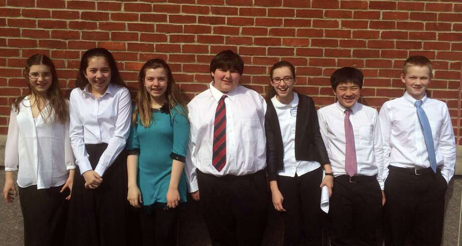 Seven students were chosen to represent Darien at the Fairfield County String Teachers Association's 40th annual String Festival March 14 and 15. They are, from left, Kara O'Rourke, Sara Baldwin, Emily Grandon, John Phipps, Elizabeth Garijo-Garde, Kai Zhou and Tal Lindsey. Photo: Contributed Photo, Contributed / Darien News