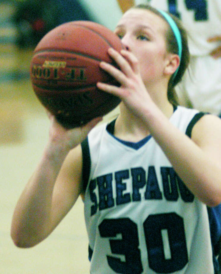 Samantha Moravsky of the Spartans focuses on a free throw during Shepaug Valley High School girls' basketball's season-ending 38-33 defeat to Terryville in Washington, Feb.22, 2014. Photo: Norm Cummings / The News-Times