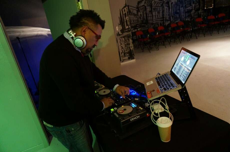 DJ FXBOX kicks off the pre-show mixer. Photo: Sketch The Journalist, 2013
