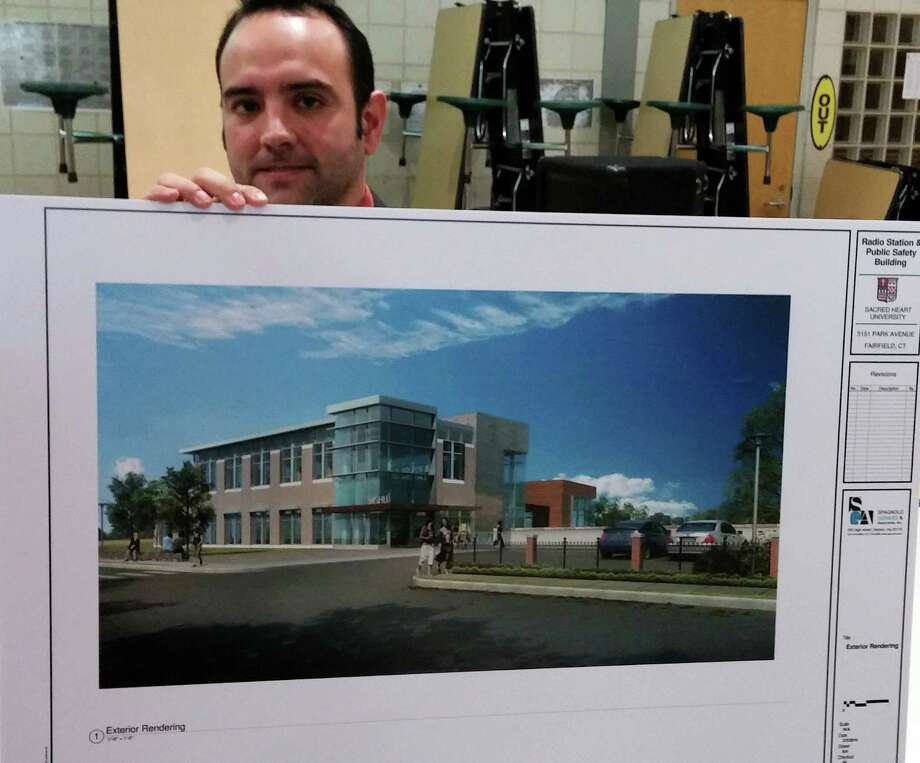 Manny Silva, a Fairfield engineer, holds a rendering that depicts a proposed campus building that would house Sacred Heart University's radio station, WSHU, as well as the school's public safety department. Photo: Andrew Brophy / Fairfield Citizen
