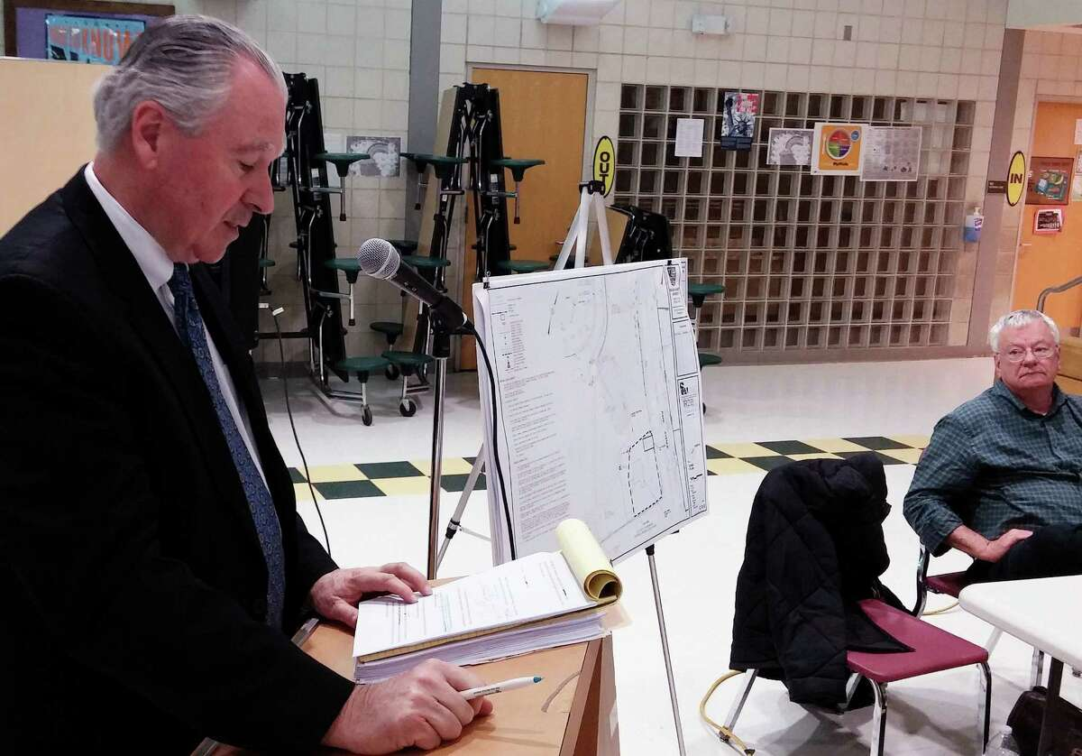 William Fitzpatrick, a lawyer representing Sacred Heart University, presents SHU's plan to build a new home for its radio station and public safety department to the Town Plan and Zoning Commission on Tuesday night.