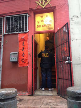 Police stand inside the Ghee Kung Tong Freemasons Lodge after a reported FBI raid in Chinatown on Wednesday morning. Photo: Kale Williams, The Chronicle