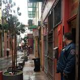 Police officers from the San Francisco Police Department stand guard in front of the Ghee Kung Tong Supreme Lodge in Chinatown after an FBI raid on Wednesday, March 26, 2014.