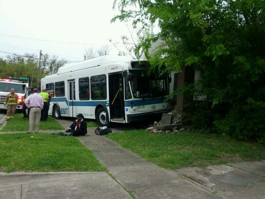 Accident on Washington Blvd. and Avenue C left a Beaumont city bus on the front steps of a house. Several people taken from the bus to the hospital. Photo: Guiseppe Barranco ‏