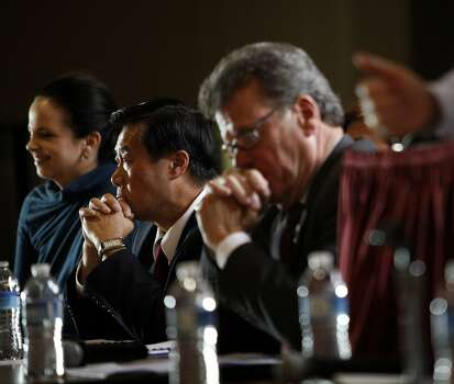 Democratic state senator Leland Yee, a San Francisco mayoral candidate, listens at the Fillmore Neighborhood Association mayoral debate in San Francisco, Calif., August 18, 2011. Photo: Sarah Rice, Special To The Chronicle