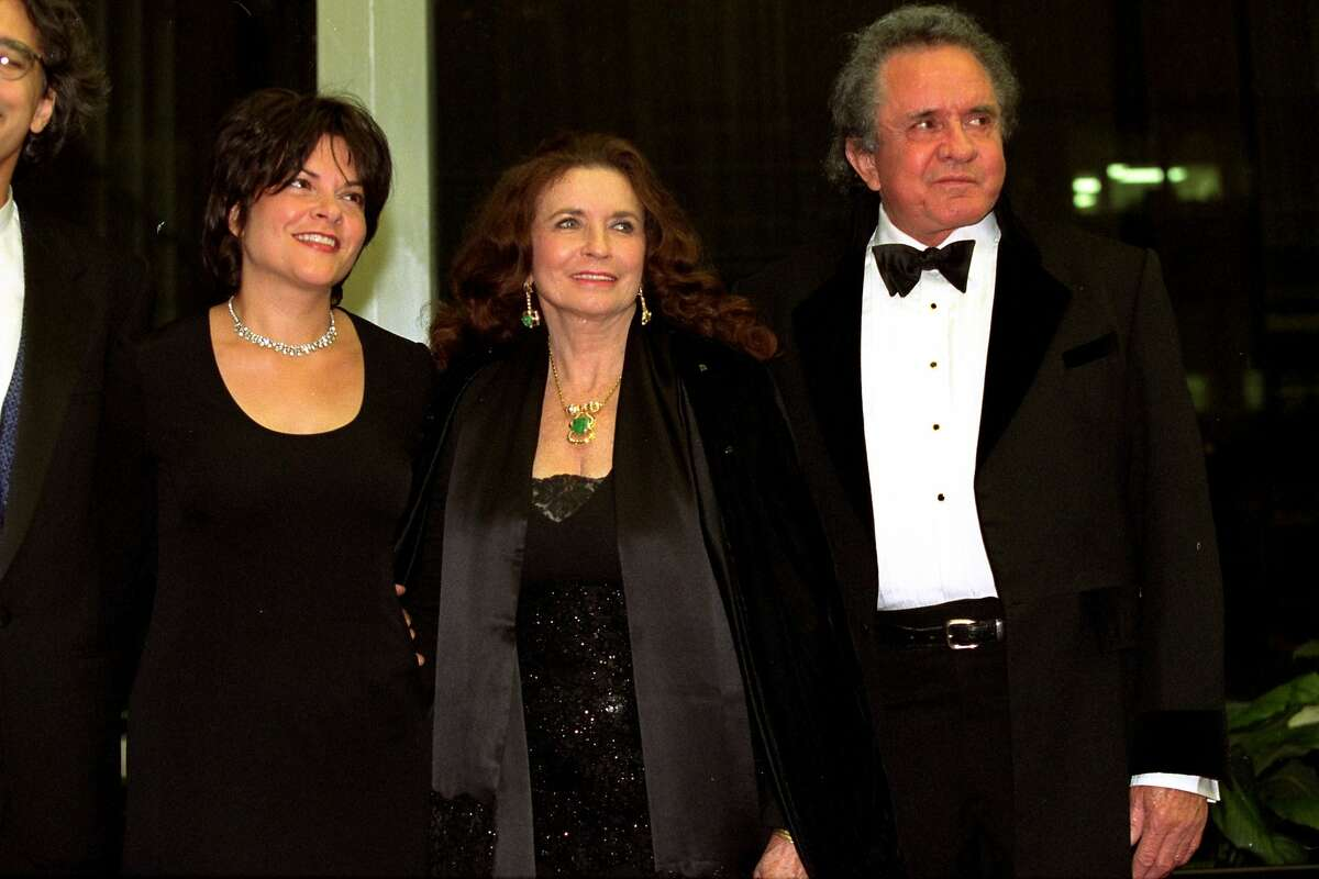 ** FILE ** Johnny Cash, right, a 1996 Kennedy Center Honors recipient, poses with his wife June Carter Cash and his daughter Roseanne Cash prior to the dinner celebrating the awards at the State Department in Washington, D.C., Dec. 7, 1996. June Carter Cash, a scion of a pioneering family in country music and the wife and Grammy-winning duet partner of singer Johnny Cash, died Thursday, May 15, 2003 of complications from heart surgery. She was 73. Cash died at Baptist Hospital in Nashville with her husband and family members at her bedside, manager Lou Robin said. (AP Photo/Tyler Mallory)