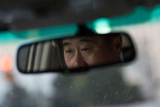 California State Senator Leland Yee of district 8 in San Francisco is reflected in his rear view mirror as he drives to his office at the state capitol in Sacramento on February 9, 2011 in San Francisco, Calif. Photo: David Paul Morris, Special To The Chronicle