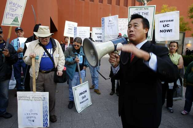 Senator Leland Yee (D-SF) talking with protestors outside of the UC campus at Mission Bay as the regents meet to hear details of UC President Mark Yudof's plan to cut $813 million from the university budget  in San Francisco, Calif., on Tuesday, July 14, 2009. Photo: Liz Hafalia, The Chronicle