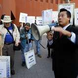 Senator Leland Yee (D-SF) talking with protestors outside of the UC campus at Mission Bay as the regents meet to hear details of UC President Mark Yudof's plan to cut $813 million from the university budget  in San Francisco, Calif., on Tuesday, July 14, 2009.