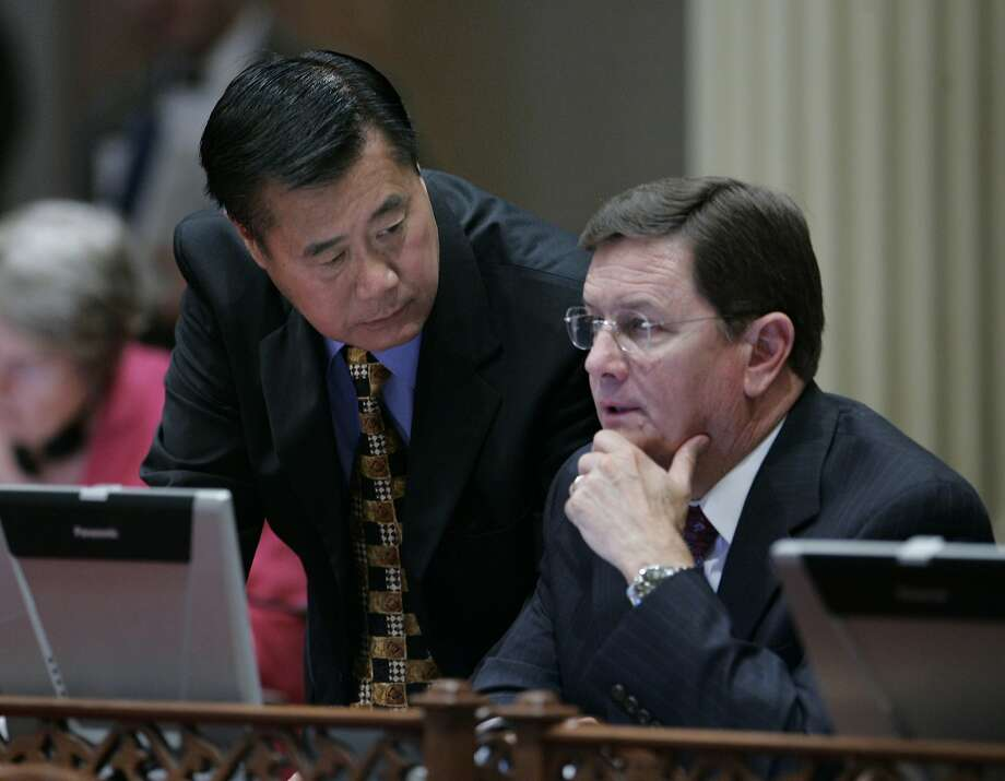 State Sen. Leland Yee, D-Daly City, left, and Senate Minority Leader Dave Cogdill, R-Modesto, confer during the Senate session at the Capitol in Sacramento, Calif., Wednesday, Aug. 27, 2008. Photo: Rich Pedroncelli, AP