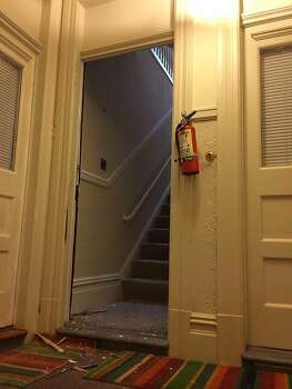 The FBI took the door off apartment on Hyde Street in San Francisco, reportedly as part of State Senator Leland Yee's corruption investigation, on Wednesday morning March 26, 2014. Photo: Vivian Ho, The Chronicle