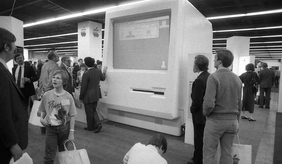 A giant model of an early Macintosh computer, top, is a centerpiece of the first Macworld trade show, held at Brooks Hall in San Francisco in 1985. The event attracted enthusiasts and those curious about the new machines. Photo: Steve Ringman, The Chronicle