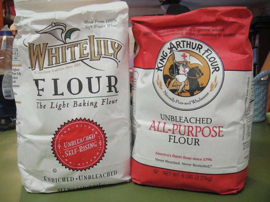 Which flour has the power? For biccuits, Southern cooks favor White Lily over the King Arthur brand in the author's cupboard. Photo: Westport News/Contributed Photo / Westport News