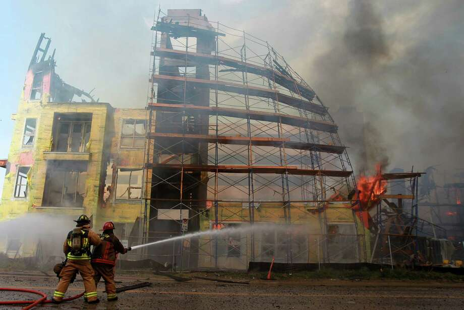 Houston Fire Department attempts to extinguish a five-alarm fire at a construction site at the corner of Marconi St. and Dallas Ave. on March 25, 2014, in Houston, Tx. Photo: Mayra Beltran, Houston Chronicle / © 2014 Houston Chronicle