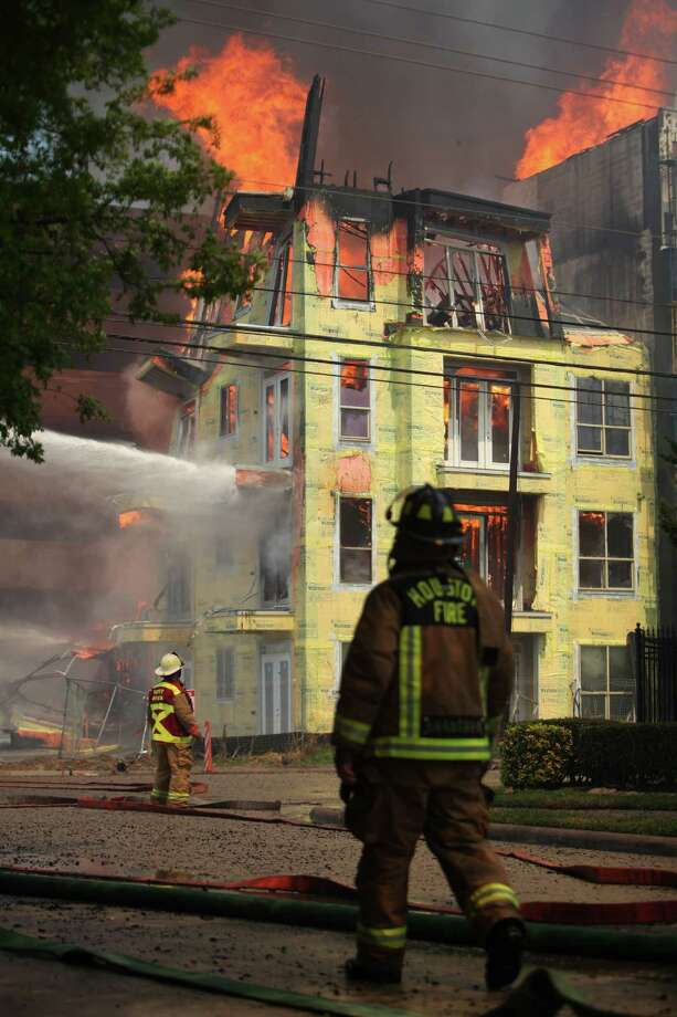 Houston Fire Department battles a fire at the corner of Marconi St. and Dallas Ave. on March 25, 2014, in Houston, Tx. Photo: Mayra Beltran, Houston Chronicle / © 2014 Houston Chronicle