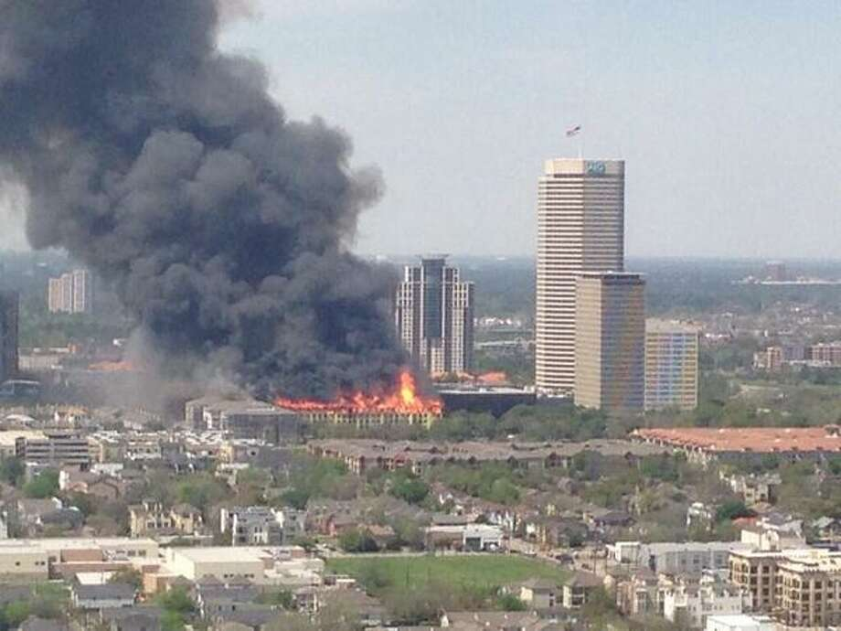 Firefighters are battling a large blaze Tuesday afternoon at an apartment building just west of downtown. The fire broke out about 12:30 p.m. on West Dallas near Montrose, according to the Houston Fire Department. Photo: @SketchtheJ On Twitter