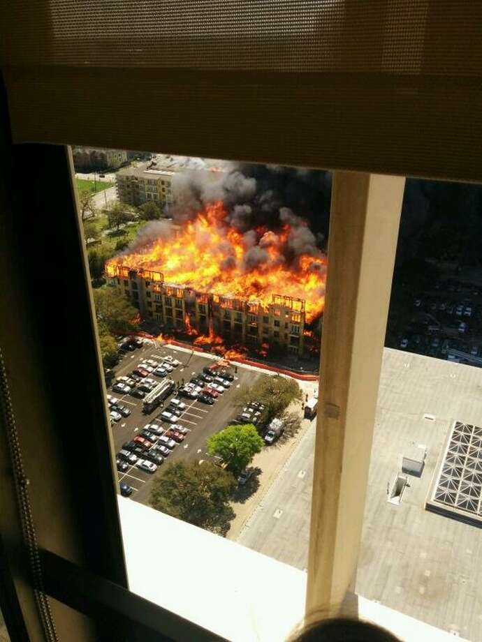 The Montrose Fire of Tuesday, March 25, 2014 as seen from the apartment window of Houston Chronicle reader Christopher Laski. Photo: Christopher Laski, @ComputerLasko On Twitter