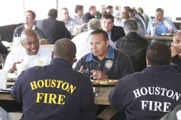 Houston Fire Department members have lunch Wednesday at Goode Company on Kirby. The restaurant is offering free barbecue sandwiches all day to Houston firefighters. Photo: Melissa Phillip, Houston Chronicle