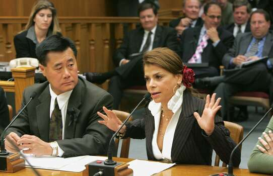 Entertainer Paula Abdul, right, urges lawmakers to approve a measure that would require stronger cleanliness standards for nail salons, during a committee hearing at the Capitol in Sacramento, Calif., Monday, June 27, 2005. Abdul told members of the Senate Business, Professions and Economic Development Committee, how she had gotten an infection while getting a manicure from a Studio City nail salon in 2004. If passed by the Legislature, the measure by Assemblyman Leland Yee, D-San Francisco, left, would strengthen cleanliness standards and require nail salons to post conspicuous notices when disciplinary action is taken against them. Photo: Rich Pedroncelli