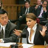 Entertainer Paula Abdul, right, urges lawmakers to approve a measure that would require stronger cleanliness standards for nail salons, during a committee hearing at the Capitol in Sacramento, Calif., Monday, June 27, 2005. Abdul told members of the Senate Business, Professions and Economic Development Committee, how she had gotten an infection while getting a manicure from a Studio City nail salon in 2004. If passed by the Legislature, the measure by Assemblyman Leland Yee, D-San Francisco, left, would strengthen cleanliness standards and require nail salons to post conspicuous notices when disciplinary action is taken against them.