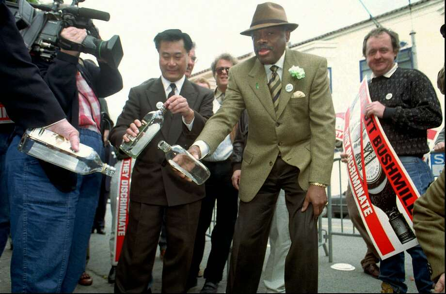 In 1997, Supervisor Leland Yee, left and San Francisco Mayor Willie Brown, center, pour several bottles of Bushmills whiskey down the drain in front of the Dovre Club, an Irish pub in San Francisco on March 17, 1997. Brown and Yee were joined by a small crowd from the pub celebrating St. Patrick's Day to pledge their support of a world-wide boycott of Bushmills in protest of what they claim are discriminatory hiring practices in the whiskey's plant in Northern Ireland. Photo: Thor Swift