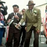 In 1997, Supervisor Leland Yee, left and San Francisco Mayor Willie Brown, center, pour several bottles of Bushmills whiskey down the drain in front of the Dovre Club, an Irish pub in San Francisco on March 17, 1997. Brown and Yee were joined by a small crowd from the pub celebrating St. Patrick's Day to pledge their support of a world-wide boycott of Bushmills in protest of what they claim are discriminatory hiring practices in the whiskey's plant in Northern Ireland.