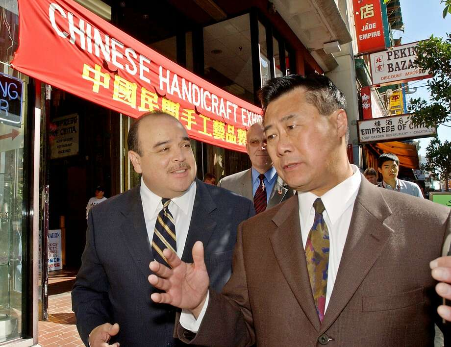Lt. Gov. Cruz Bustamante, left, listens to State Assemblyman Leland Yee, D-San Francisco, right, as they walks on Grant Ave. during Bustamante's campaign in San Francisco's Chinatown, Monday, Oct. 6, 2003 before Tuesday's recall election. Photo: Paul Sakuma