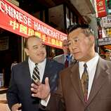 Lt. Gov. Cruz Bustamante, left, listens to State Assemblyman Leland Yee, D-San Francisco, right, as they walks on Grant Ave. during Bustamante's campaign in San Francisco's Chinatown, Monday, Oct. 6, 2003 before Tuesday's recall election.
