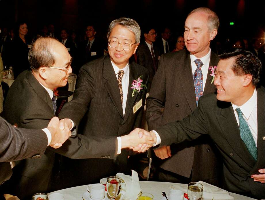 From left, Chinese General Consul Zeng Shou Song, Hong Kong Economic and Trade Office Director Michael Lee, British Consul General Malcolm Dougal and San Francisco Supervisor Leland Yee exchange handshakes and good wishes at a breakfast in San Francisco Monday, June 30, 1997 held to witness, via satellite, the handover of Hong Kong. Photo: Sam Morris