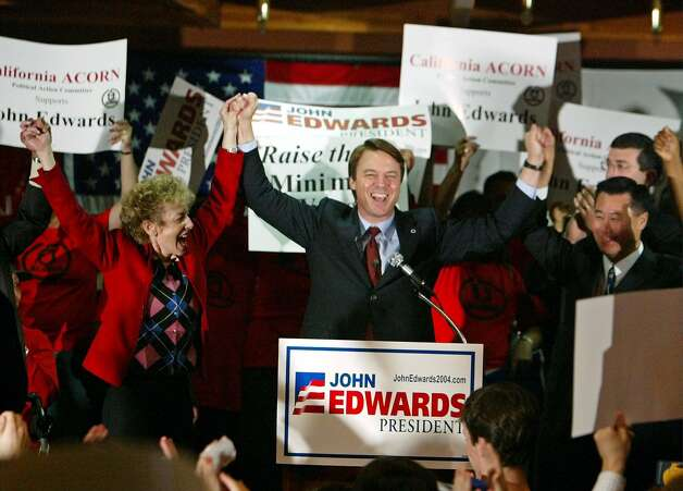 Democratic presidential hopeful Sen. John Edwards, D-N.C., center, raises his arms with state Board of Equalization Chairwoman Carole Migden, left, and state Assemblyman Leland Yee, right, after giving a campaign speech at the Delancey Street Auditorium in San Francisco, Thursday Feb. 26, 2004. Photo: Eric Risberg