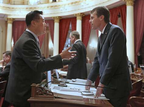 State Sen. Leland Yee, D-San Francisco, left, discusses his bill to make it illegal for employers and college admissions officers to ask for  current or prospective workers and students  for their social media passwords, with Sen. Ted Gaines, R-Granite Bay  in Sacramento, Calif., Friday,  May 25, 2012.  Gaines . who was one of several GOP members who voted against the bill , said he supports the intent  but is concerned that it's too broad.  Despite the opposition the bill was approved on a 28-5 vote and sent to the Assembly. Photo: Rich Pedroncelli, AP