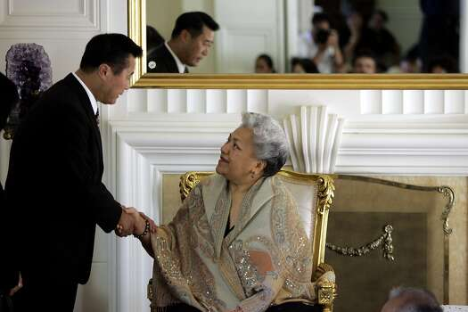 Assemblyman Leland Yee, left, Speaker pro Tempore, D-San Francisco, pays his respects to Princess Mele Siu'ilikutapu, right, sister of Princess Kaimana, during a memorial service at the Tongan Royal estate in Hillsborough, Calif., Wednesday, July 12, 2006.  The service was held for the Tongan royal family members, Prince Tu'ipelehake, 56, Princess Kaimana, 46, and their driver, Vinisia Hefa, 36 who were killed in a vehicle accident in Menlo Park, Calif., on July 5, 2006. Photo: Paul Sakuma