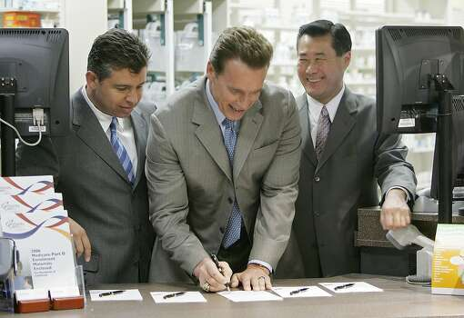 California State Assemblyman Leland Yee (D-San Francisco) (right) and California State Senator Abel Maldonado (R-Santa Maria) (left) look on as California Governor Arnold Schwarzenegger signs emergency prescription drug legislation at a Safeway pharmacy January 20, 2006 in Alameda, California. Gov. Schwarzenegger signed state bill AB132,  the legislation will provide emergency access to prescription drugs for vulnerable Californians who are having difficulties with the new Medicare prescription drug program.  Photo: Justin Sullivan