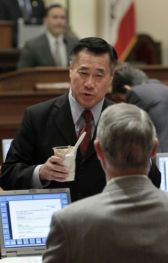 State Sen.Leland Yee, D-San Francisco, left, who had recently received death threats because of his proposed gun control legislation, talks with Sen. Bill Emmerson, R-Redlands at the Capitol in Sacramento, Calif., Friday, Feb. 15, 2013.   Everett Basham, 45, appeared in Santa Clara County Superior Court, Friday, where he was arraigned on a dozen charges for allegedly threatening Yee. Photo: Rich Pedroncelli, AP