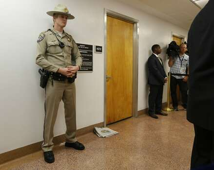 A California highway patrol officer stands outside the office of Sen. Leland Yee, D-San Francisco, at the state Capitol, Wednesday, March 26, 2014, in Sacramento, Calif. FBI spokesman Peter Lee said Yee was arrested Wednesday, he declined to discuss the charges, citing an ongoing investigation. (AP Photo/Rich Pedroncelli) Photo: Rich Pedroncelli, Associated Press