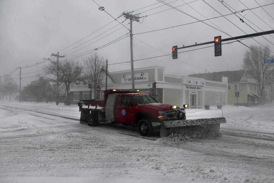A snowplow drives down Main Street  during a snowstorm March 26, 2014 in Hyannis, Massachusetts. An early spring storm brought high winds and some snow accumulation, with blizzard conditions expected to last throughout the morning. Photo: Darren McCollester, Getty Images / 2014 Getty Images