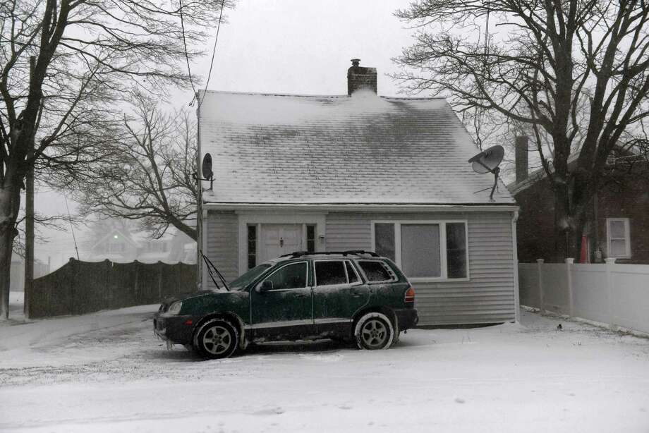 A car sits in the driveway of a snow swept home during a snowstorm on North Street March 26, 2014 in Hyannis, Massachusetts. An early spring storm brought high winds and some snow accumulation, with blizzard conditions expected to last throughout the morning. Photo: Darren McCollester, Getty Images / 2014 Getty Images