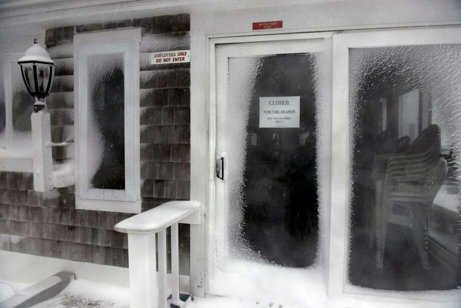 A snow covered business sits closed for the season during a snowstorm March 26, 2014 in Hyannis, Massachusetts. An early spring storm brought high winds and some snow accumulation, with blizzard conditions expected to last throughout the morning. Photo: Darren McCollester, Getty Images / 2014 Getty Images